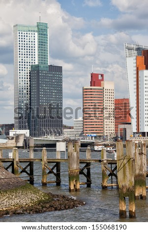 City of Rotterdam downtown skyline and wooden pier on Nieuwe Maas (New Meuse) river in Netherlands, South Holland province. - stock photo
