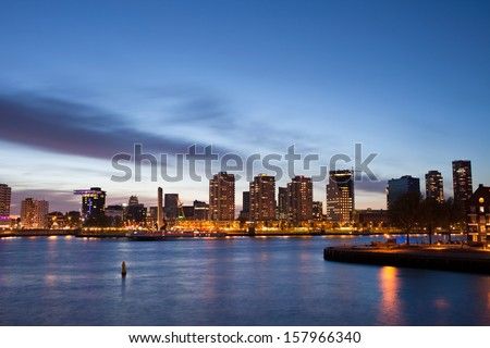 City of Rotterdam river view at twilight in Netherlands, South Holland province. - stock photo