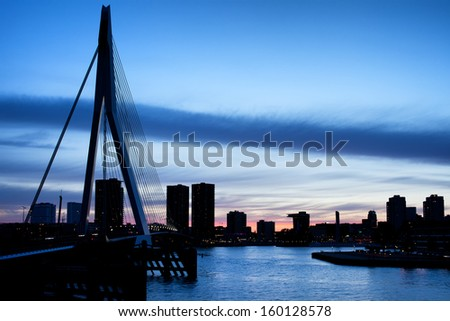 City of Rotterdam skyline silhouette at dusk in the Netherlands, South Holland province. - stock photo