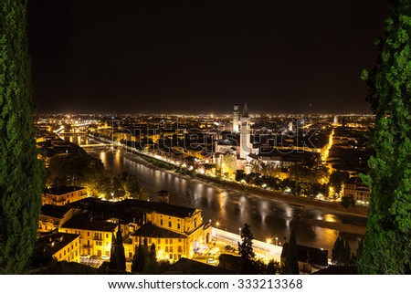 City of Verona by night with river - stock photo