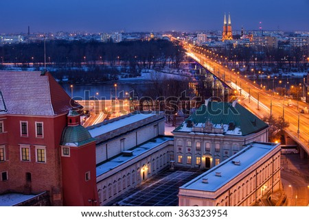 City of Warsaw by night in Poland, winter cityscape, part of Royal Castle, Copper-Roof Palace (Pod Blacha), Solidarity Avenue
