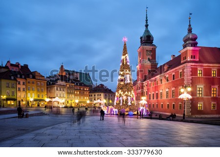 City of Warsaw in Poland by night, Old Town, Royal Castle, Christmas Tree and old tenement houses.