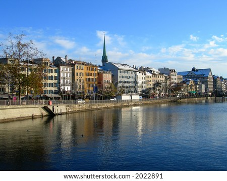 City of Zurich (Switzerland) seen from the bridge over river Limmat, in winter