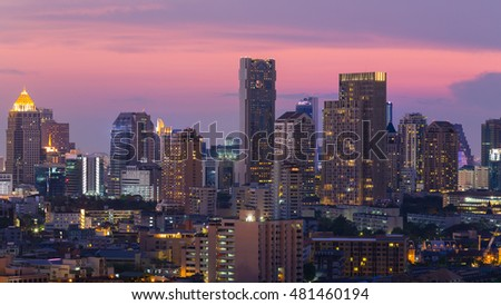 City office building light night view with after sunset sky background