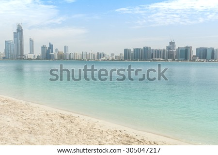 City on the water in Arabic Emirates with sand shore