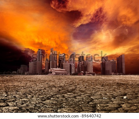 City overlooking desolate desert landscape with cracked earth