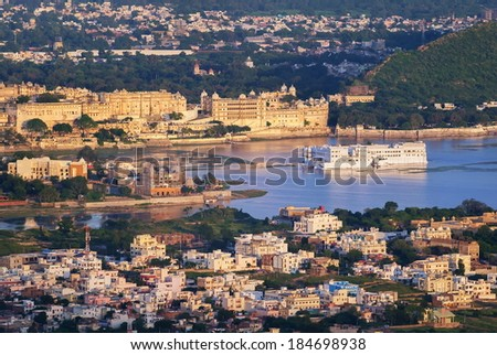 City Palace and famous Taj Lake Palace Hotel on Pichola lake in Udaipur, India - stock photo