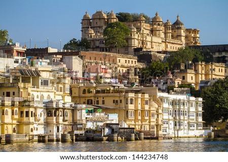 City Palace and Pichola lake in Udaipur, Rajasthan, India - stock photo