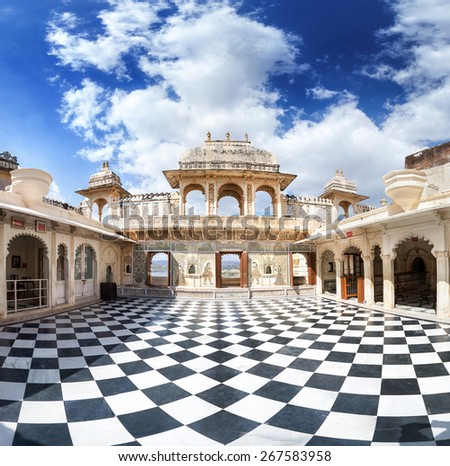 City Palace museum with surreal chess floor in Udaipur, Rajasthan, India - stock photo