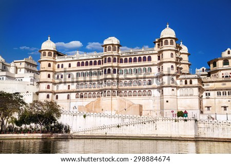 City Palace on Lake Pichola at blue sky in Udaipur, Rajasthan, India - stock photo