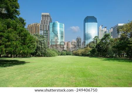 city park with modern building background (Bangkok,Thailand) - stock photo