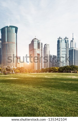 city park with modern building background in china - stock photo