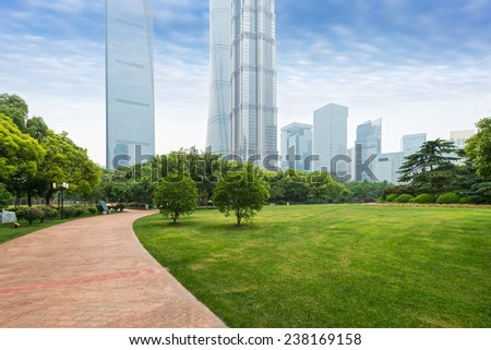 city park with modern buildings background in shanghai - stock photo