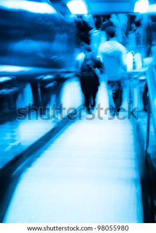 city passenger on elevator at subway station abstract blur - stock photo