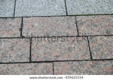 City pavement texture, brick road pattern made of granite - stock photo