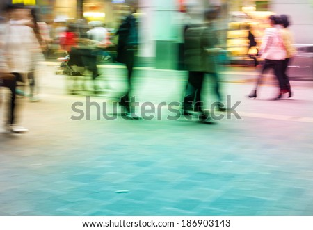 City people on commercial street, abstract blur background