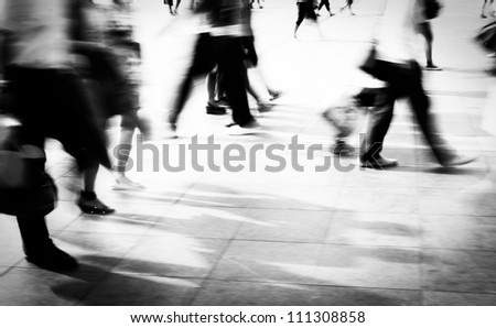 city people walking on piazza in motion blur - stock photo