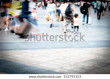 city people walking on piazza in motion blur