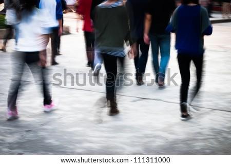 city people walking on street in motion blur - stock photo