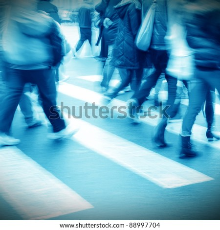 city person crossing street blur motion - stock photo