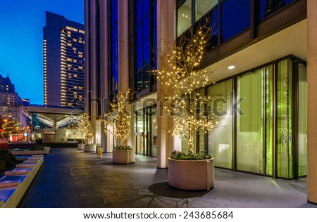 City plaza at night. Night scene of colorful city life with skyscrapers, highrise buildings. Vancouver downtown  at night. - stock photo