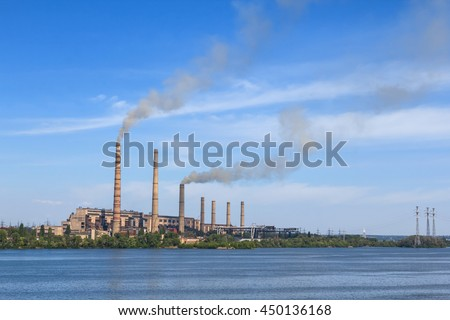 city power plant on a river