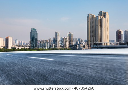 city road against the buildings,motion blurred. - stock photo