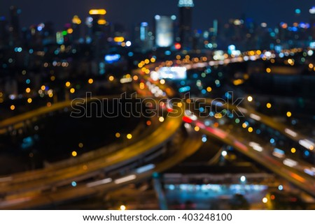 City road interchange night view, abstract blurred bokeh light background - stock photo