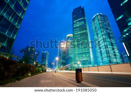 City road light trails of streetscape office buildings backgrounds in shanghai
