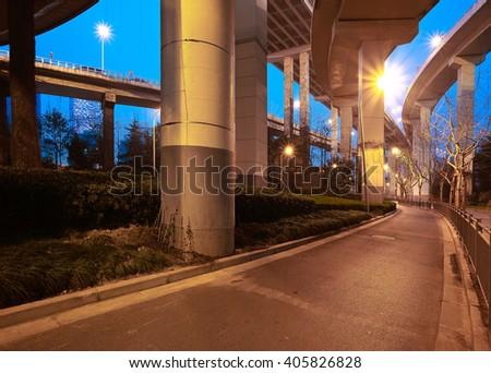 City road viaduct streetscape of night scene in shanghai - stock photo