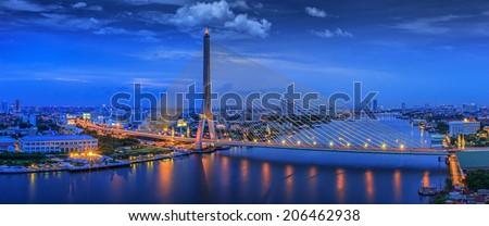 City scape of Rama VIII Bridge at night in Bangkok and Chopraya river, Thailand - stock photo