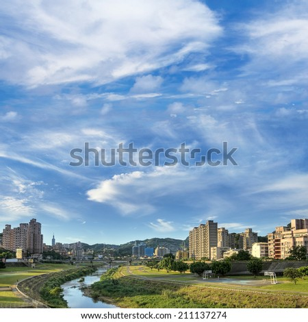 City scenery of park and river under blue sky and white clouds in Taipei, Taiwan. - stock photo