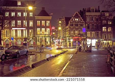 City scenic from Amsterdam in the Netherlands  at night - stock photo