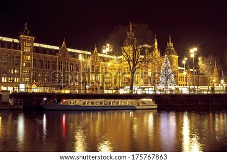 City scenic from Amsterdam in the Netherlands with the central station at night