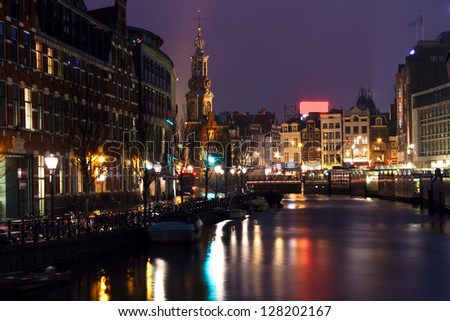 City scenic from Amsterdam with the Munttower at night in the Netherlands