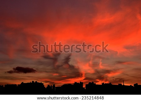 City shape on a red sunset background.