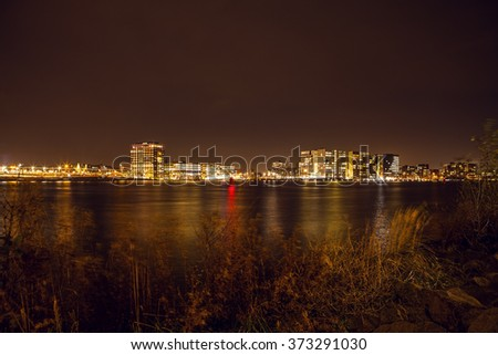 City sights of Amsterdam at night. General views of city landscape.