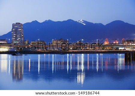 city skyline and Grouse Mountain ski resort above Vancouver British Columbia Canada
