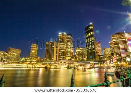 City Skyline at Circular Quay by night, Sydney, Australia. - stock photo