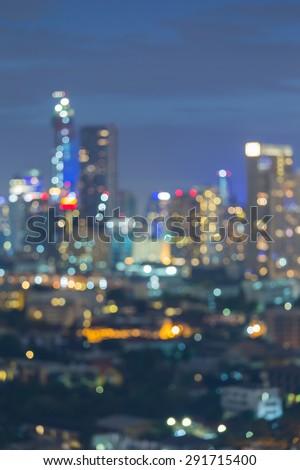 City skyline bokeh lights during twilight  - stock photo