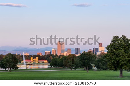 City skyline of Denver Colorado from the City Park taken from front of Science Museum just before sunrise with the fountain and Boathouse and Ferril Lake - stock photo