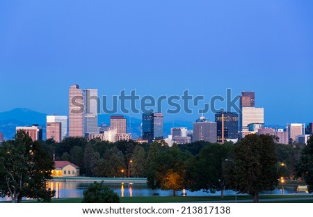 City skyline of Denver Colorado from the City Park taken from front of Science Museum just before sunrise - stock photo