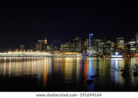 City Skyline Reflection on water at night - stock photo
