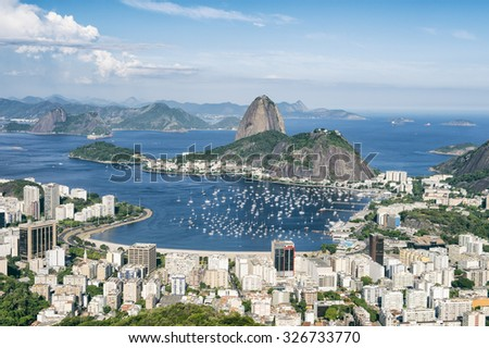 City skyline scenic overlook of Rio de Janeiro, Brazil with Sugarloaf Mountain, Botafogo and Guanabara Bay - stock photo