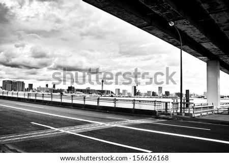 City skyline seen from underneath bridge - stock photo