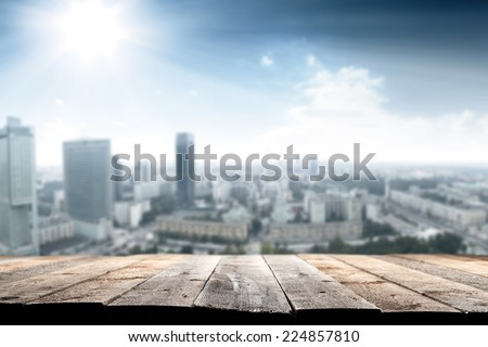 city space of blue color and wooden terrace space  - stock photo