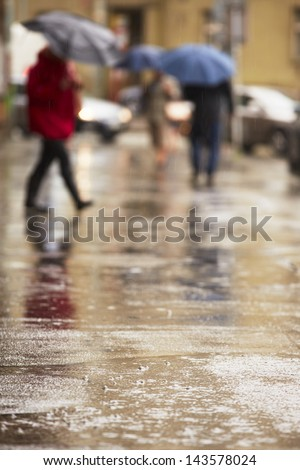 City street in heavy rain - selective focus - stock photo
