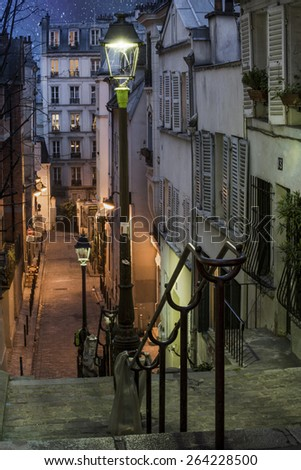 City Street in Montmartre area of Paris, France at night - stock photo