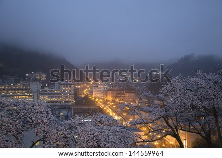 City town at night in japan - stock photo