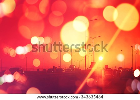 City traffic in sunset, cars on Roadway,retro toned image with bokeh light - stock photo